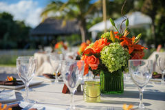 Alfresco dining. Dinner table set for dining outside with a centrepiece flower arrangement royalty free stock photography