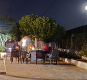 Alfresco dinner on a patio in Greece. Royalty Free Stock Images