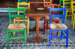 Alfresco outdoor cafe with multicolored chairs, Greece Royalty Free Stock Photography