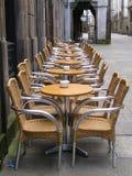 Alfresco sidewalk dining cafe. Alfresco dining furniture at a street bar terrace. Urban setting royalty free stock photography