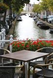 Alfresco table of a bar and canal Stock Photo