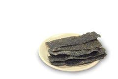Alga marina frita en la placa Imagen de archivo libre de regalías