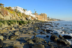 Algae covered boulders on shore of Cress Street Beach  in Laguna Beach, California. Royalty Free Stock Images