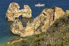 Algarve Coast Lagos and boat, Portugal. Royalty Free Stock Photography