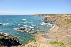 Algarve: Coastline with cliffs and small beach near Praia de Odeceixe, Portugal Stock Images