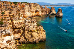 Algarve coastline in Portugal. Rocks and Sea in Lagos Royalty Free Stock Images