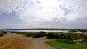 Algarve golf course scenery at Ria Formosa. Portugal. (Pan Timelapse) stock video footage