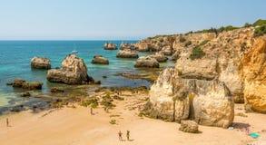 Scenic golden cliffs near Alvor, Portimao, Algarve Stock Photos