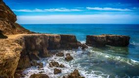 Algarve, Portugal: rocks in the coast of Albufeira. At sunrise royalty free stock photo