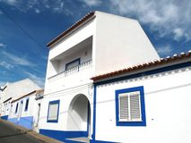 Algarve's blue under the blue. Soutern's portugal Algarve's houses with the typical colored stripes under an amazing blue sky stock images