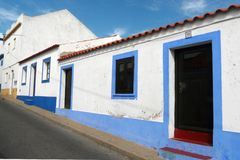 Algarve's houses. Soutern's portugal Algarve's houses with the typical colored stripes under a blue sky stock image