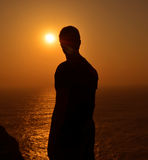 Algarve solnedgångsilhouette Arkivfoto