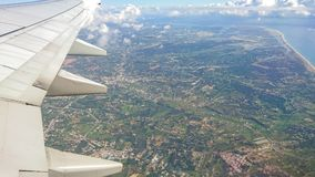 Algarve, southern Portugal aerial shot over the wing of a plane royalty free stock photography