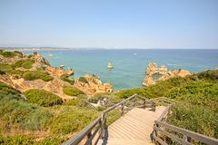 Algarve: Stairs to beach Praia do Camilo near Lagos, Portugal Royalty Free Stock Photo