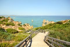 Algarve: Stairs to beach Praia do Camilo near Lagos, Portugal Royalty Free Stock Photography