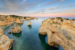 Algarve summer vacations destinations in Portugal. Marinha Beach at sunset Stock Photos