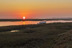 Algarve sunset seascape at Ria Formosa wetlands reserve. Southern Portugal, famous nature destination Royalty Free Stock Images