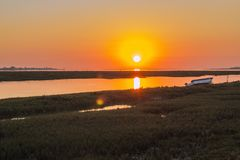 Algarve sunset seascape at Ria Formosa wetlands reserve, souther. N Portugal, famous nature destination Royalty Free Stock Image