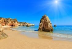 Algarve sunshiny beach Dos Tres Irmaos Portugal. Sandy beach Dos Tres Irmaos sunshiny summer view Portimao, Alvor, Algarve, Portugal Royalty Free Stock Photo