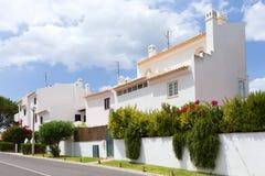 Algarve villas. A view of typical villas by the street in Algarve, Portugal stock photos