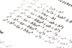 Algebra formulas. Close up of a textbook with algebra formulas stock images