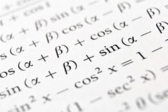 Algebra formulas close up. Close up of a textbook with algebra formulas and problems royalty free stock images