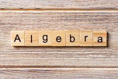 Algebra word written on wood block. Algebra text on table, concept.  royalty free stock image