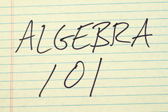 Algebra 101 On A Yellow Legal Pad. The words `Algebra 101` on a yellow legal pad stock photo