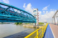 Algera bridge and storm surge barrier. The Algera storm surge barrier is a hydraulic engineering work in the very large Dutch Delta Works project.  The barrier Royalty Free Stock Images