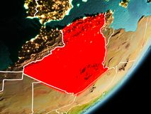 Orbit view of Algeria. Algeria in early morning light highlighted in red on planet Earth with visible border lines and city lights. 3D illustration. Elements of Royalty Free Stock Photography