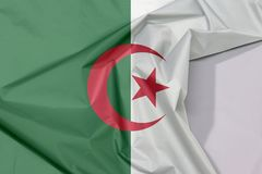 Algeria fabric flag crepe and crease with white space. Algeria fabric flag crepe and crease with white space, it is of two equal vertical bars, green and white royalty free stock photos