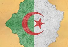 Algeria flag in big concrete cracked hole and broken material. Facade structure Stock Photography