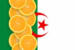 Algeria flag and citrus fruit slices vertical row. Algeria flag and vertical row of orange citrus fruit slices. Concept of growing as well as import and export stock images