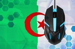 Algeria flag and computer mouse. Concept of country representing e-sports team. Algeria flag and modern backlit computer mouse. Concept of country representing e stock photo