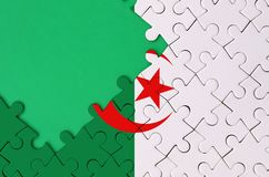 Algeria flag is depicted on a completed jigsaw puzzle with free green copy space on the left side.  vector illustration