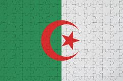 Algeria flag is depicted on a folded puzzle stock illustration