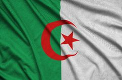 Algeria flag is depicted on a sports cloth fabric with many folds. Sport team banner. Algeria flag is depicted on a sports cloth fabric with many folds. Sport stock images