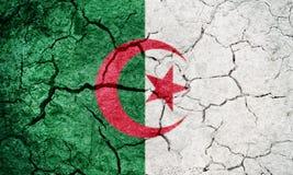People`s Democratic Republic of Algeria flag. Algeria flag on dry earth ground texture background Stock Photos