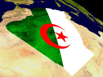 Algeria with flag on Earth Royalty Free Stock Images