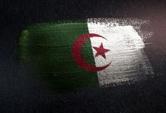 Algeria Flag Made of Metallic Brush Paint on Grunge Dark Wall.  stock photo