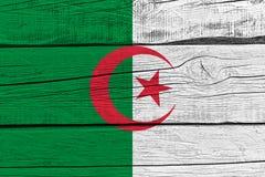 Algeria flag painted on old wood plank. Patriotic background. National flag of Algeria stock illustration