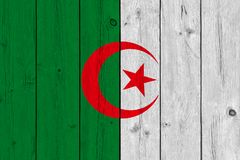 Algeria flag painted on old wood plank. Patriotic background. National flag of Algeria stock images