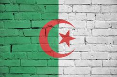 Algeria flag is painted onto an old brick wall stock photography
