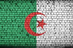 Algeria flag is painted onto an old brick wall royalty free stock photo