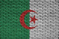 Algeria flag is painted onto an old brick wall royalty free stock photography