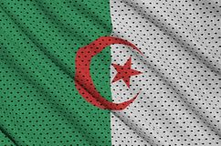 Algeria flag printed on a polyester nylon sportswear mesh fabric. With some folds stock illustration