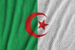 Algeria flag printed on a polyester nylon sportswear mesh fabric. With some folds royalty free stock photos
