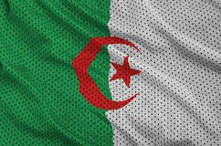 Algeria flag printed on a polyester nylon sportswear mesh fabric. With some folds royalty free stock image