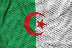 Algeria flag printed on a polyester nylon sportswear mesh fabric. With some folds stock photo