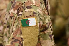 Algeria flag on soldiers arm. People`s Democratic Republic of Algeria troops collage royalty free stock image